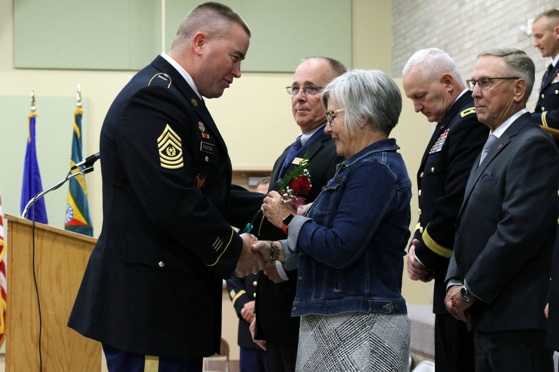 Command Sergeant Major Erikson presents a rose to the family of Colonel (ret.) Wayne M. Hayes during the Court of Honor Induction Ceremony on Camp Ripley on October 6th 2019.