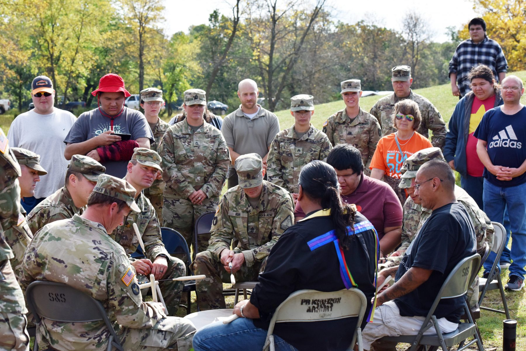 Members of the Minnesota National Guard welcomed students form the Bug-O-Nay-Ge-Shig School, Onamia Public Schools and Nay Ah Shing Schools onto Camp Ripley Sept. 20, 2019 to share in a cultural exchange while participating in the harvesting of sage, planting of natural prairie plants and to sharing in information about each other.
